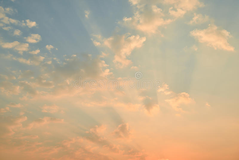 Sunset sky with clouds and golden light. Golden sunset sky with clouds and golden light stock image