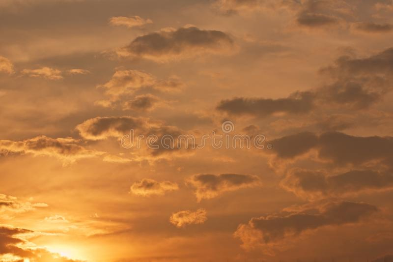 Sunset sky with clouds. Setting sun in cloudy sky royalty free stock photo