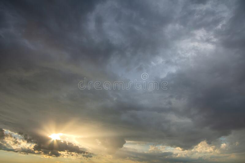 Sunset sky covered with dramatic storm puffy clouds before rain.  stock image