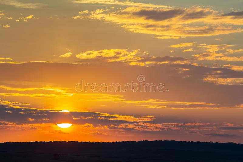 Sunset sky covered with orange puffy clouds in the evening.  royalty free stock photography