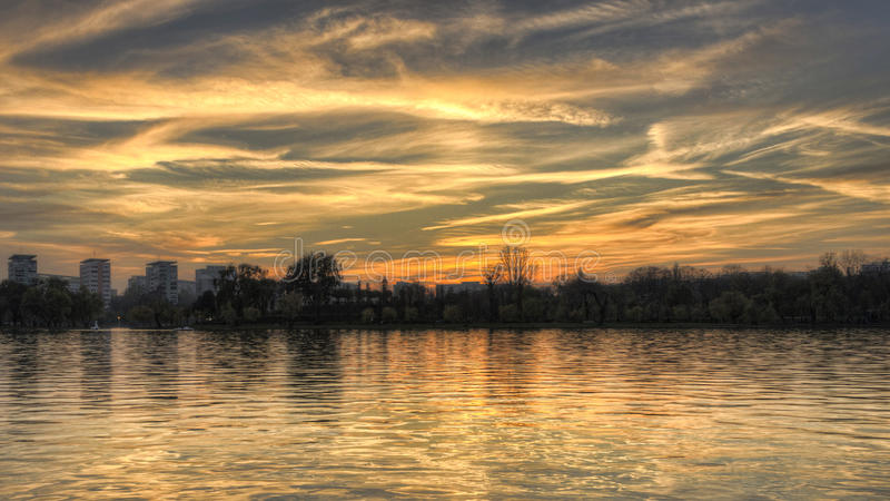Sunset Sky Design - HDR photo. A beautiful sky design from the Sun and clouds stock photo