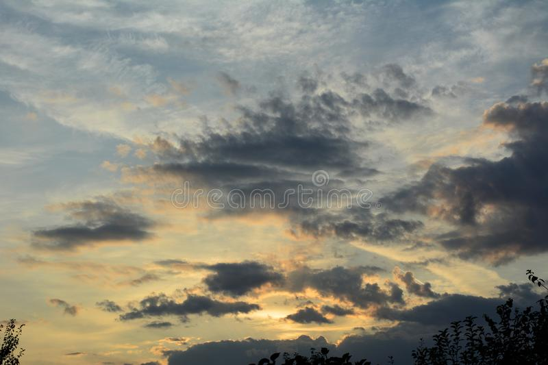 Sunset sky in the evening with light and dark clouds.  stock images
