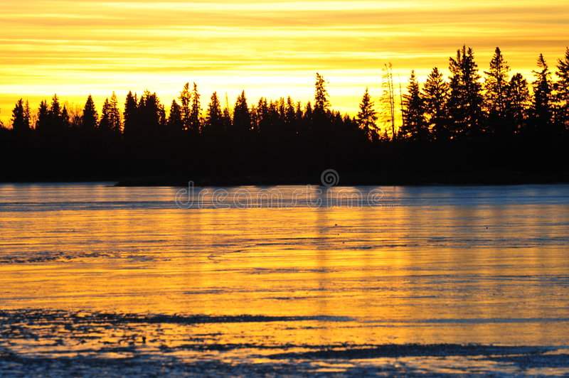 Sunset sky and ice lake royalty free stock photos
