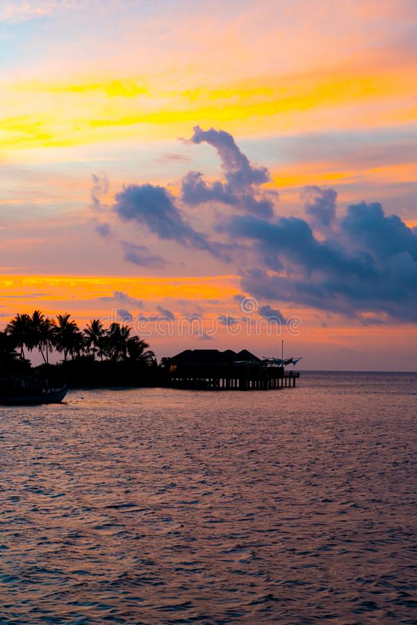 Sunset sky with Maldives Island. Beautiful sunset sky with Maldives Island stock photo