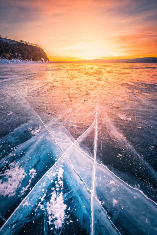 Sunset sky with natural breaking ice over frozen water on Lake Baikal, Siberia, Russia.  stock image