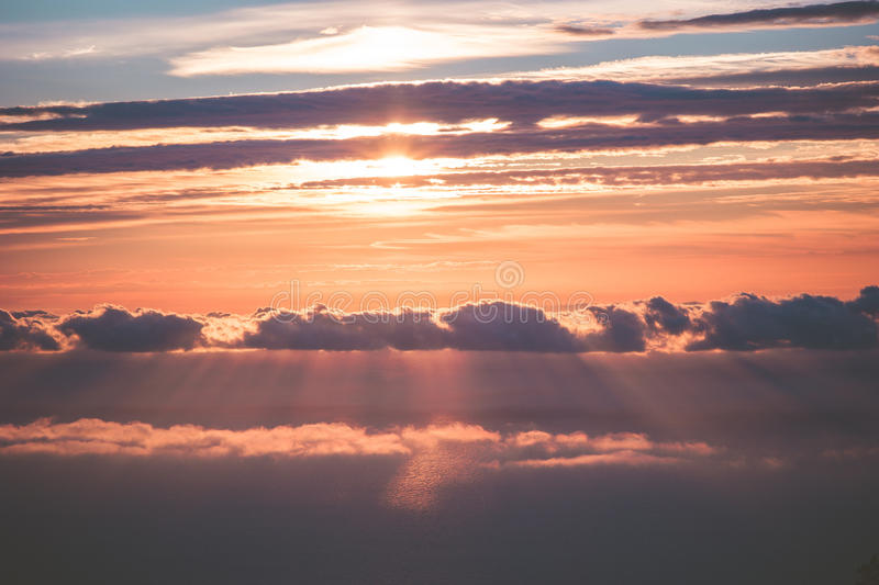 Sunset Sky over clouds Landscape. Travel serene scenic view flying beautiful natural colors stock image