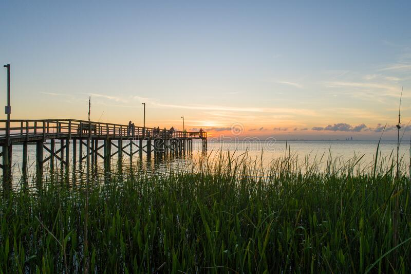 Sunset sky over Mobile Bay, Alabama at Daphne Bayfront Park on the Gulf Coast waterfront royalty free stock images
