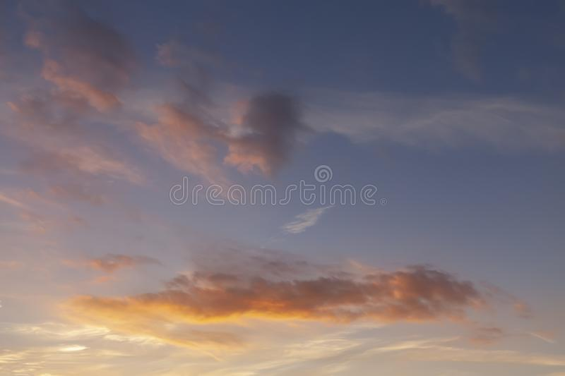 Sunset sky and pink clouds 428. Sunset sky and pink clouds with a blue background sky stock photography