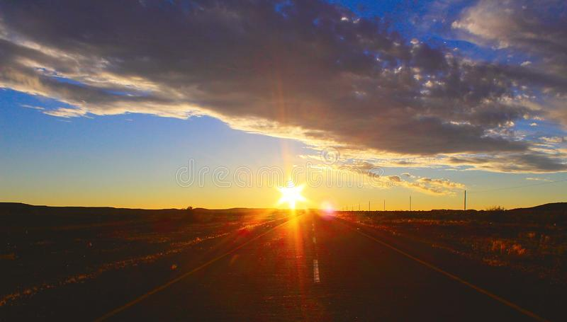 Sunset sky and road in the desert royalty free stock image