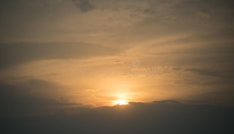 Sunset sky with sun and clouds, nature stock photography