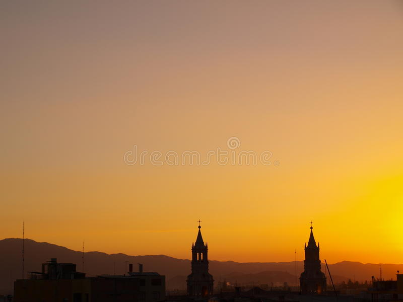 Sunset sky with twin church towers royalty free stock photo