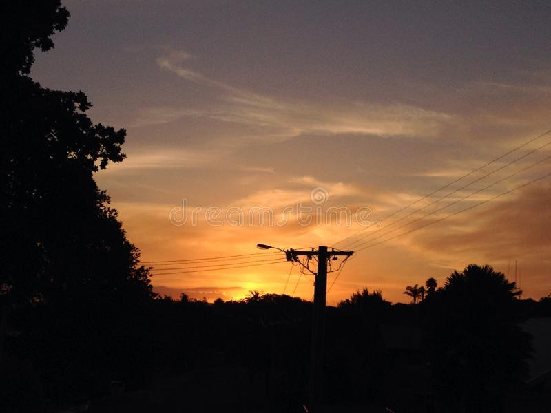 Sunset skyline with power lines stock photo