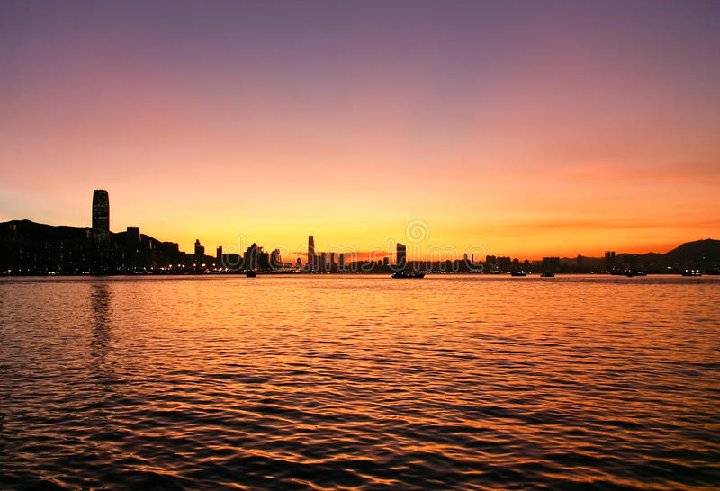 Sunset and skyline of Victoria Harbor, Hong Kong stock images