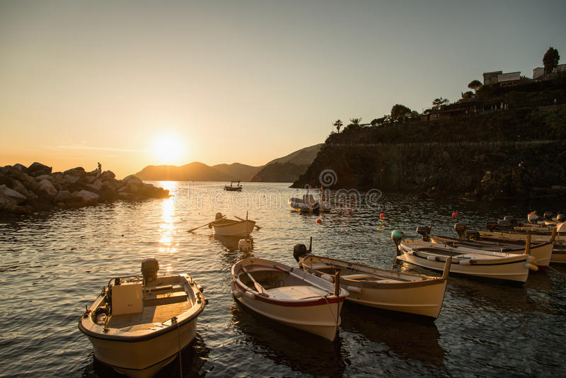 Sunset in small harbor of Manarola, Cinque Terre royalty free stock photography