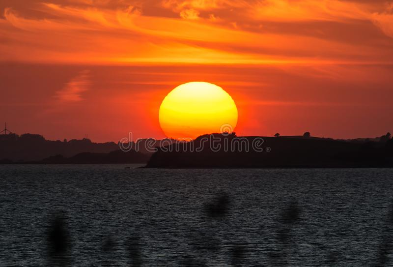 Sunset - South of Fyn, Denmark. Sunset from the small island Svelmoe, South of Fyn, Denmark royalty free stock image
