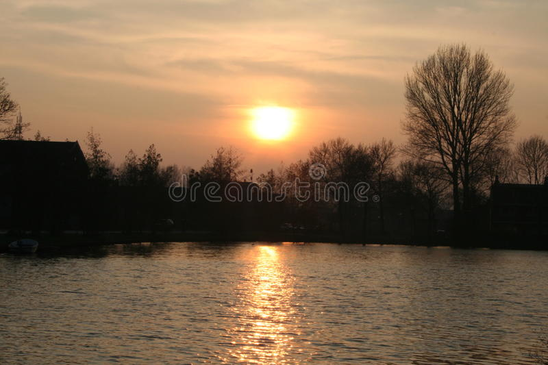 Sunset. A sunset in a small town situated near a river royalty free stock image