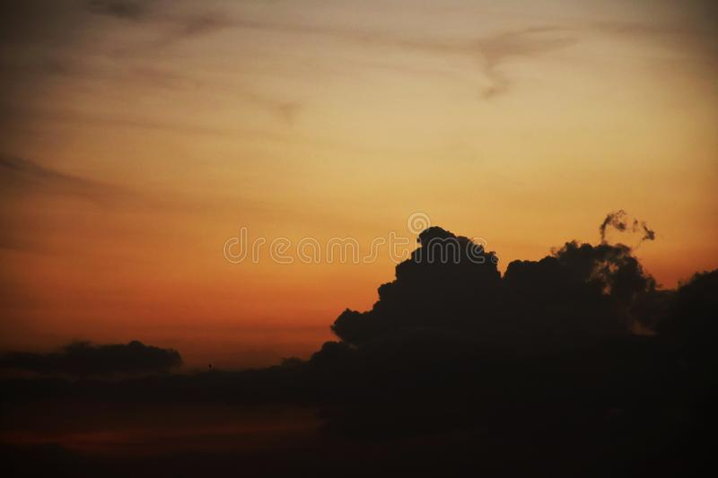 Sunset with smoky clouds royalty free stock photography