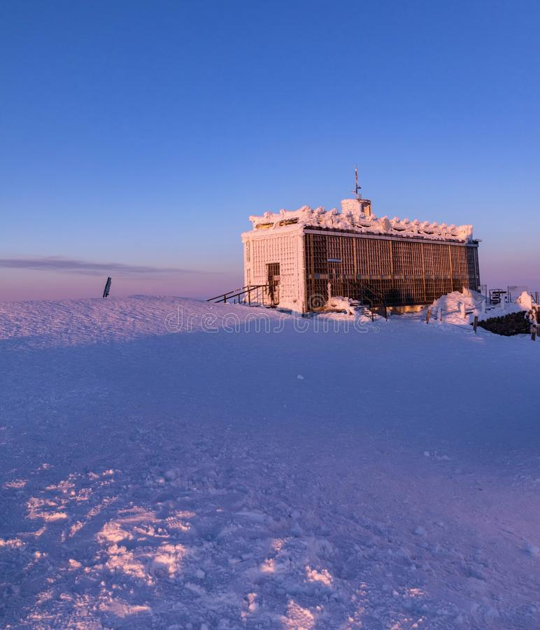 Sunset at Snezka. Post office on top of Snezka covered with frost. The peak of the Snezka Mountain in winter in the Krkonose stock images