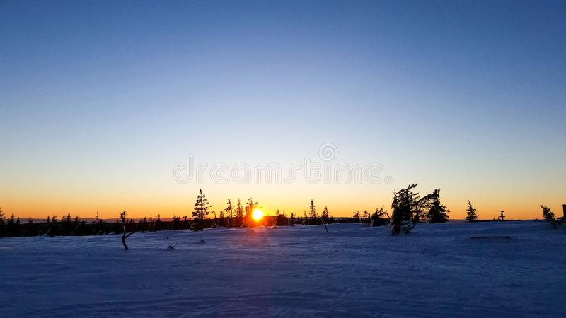 Sunset with snowcovered landscape. Sunset with snowcovered landscape in Hedmark county Norway royalty free stock photos