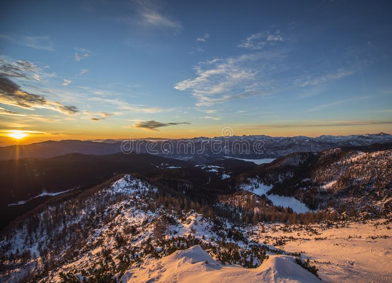 Sunset in the snowy mountains in a spectacular atmosphere royalty free stock photo