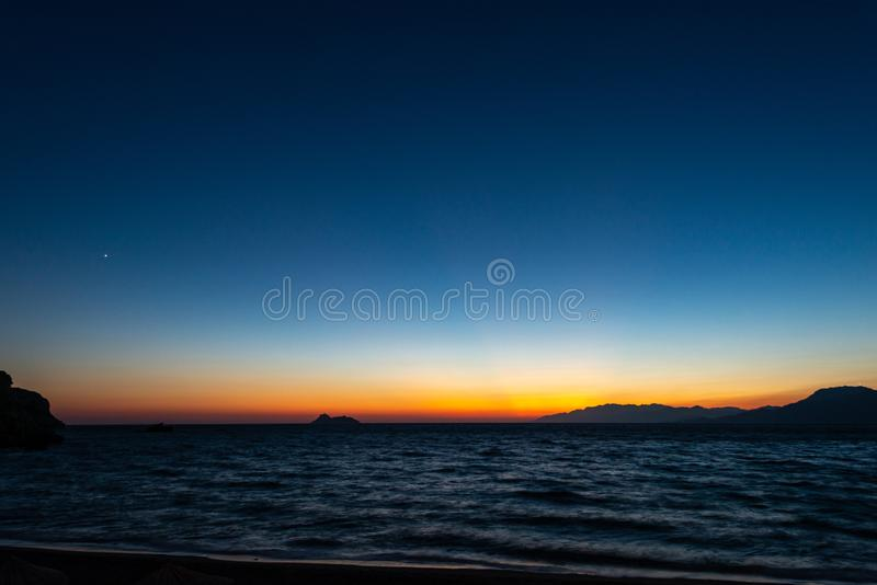 Sunset at the south of Crete. Sunset with a dark blue sky turning into bright orange at the south of Crete royalty free stock images