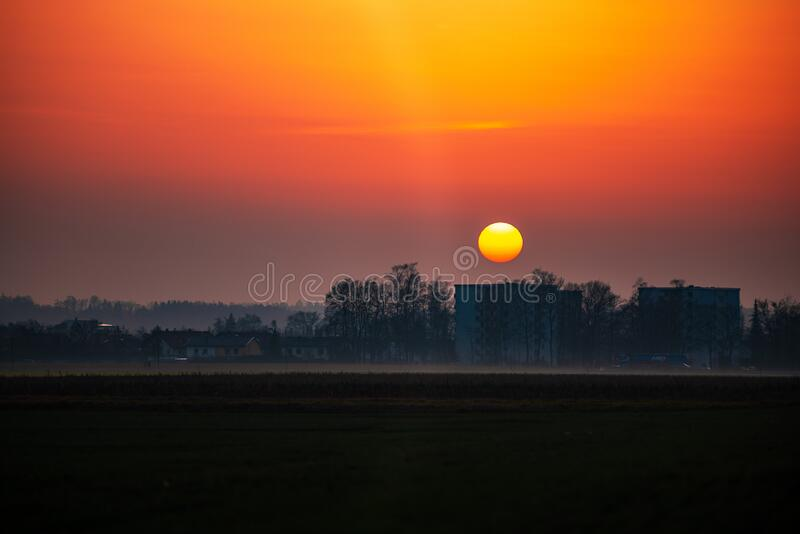 Sunset in southern Germany. View of sun setting behind buildings in winter in southern Germany royalty free stock image