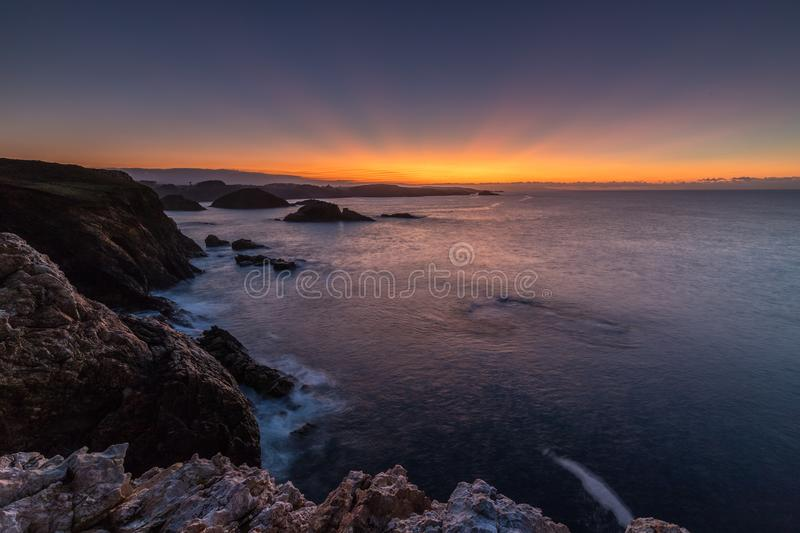 Sunset spectacular on the coast of galicia. On a cold and autumnal day stock image
