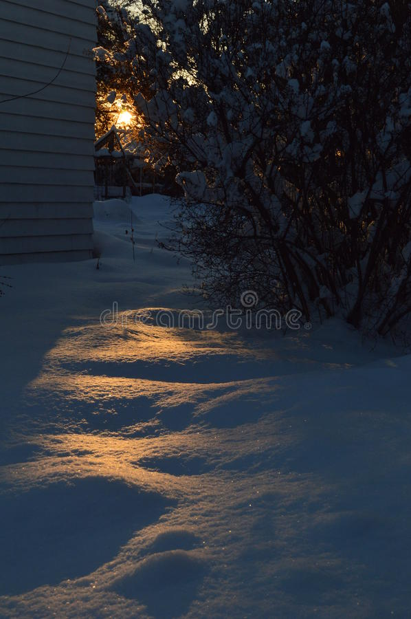 Download Sunset spills across snow stock image. Image of frozen - 84140969