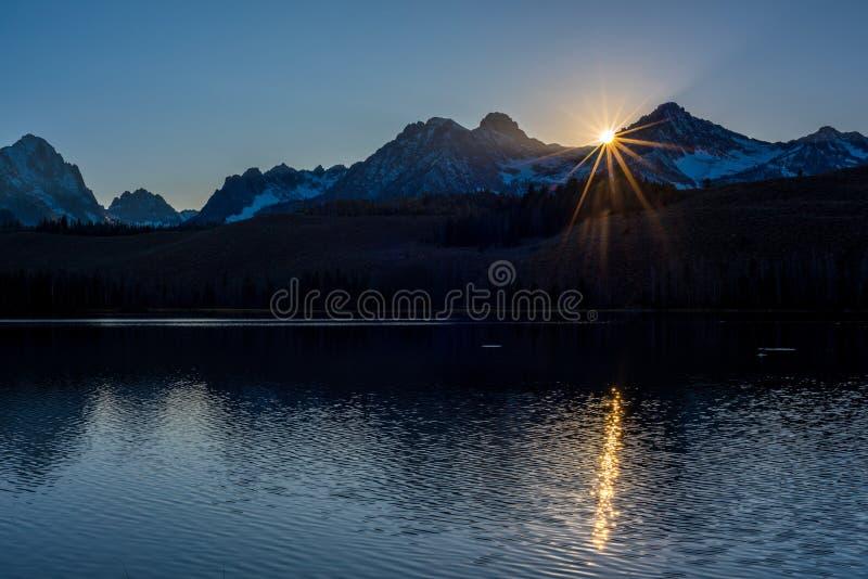 Sunset star over Redfish Lake in Idaho stock photo