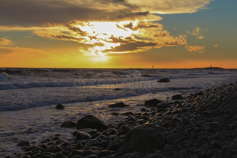 Sunset on a stone beach stock photo