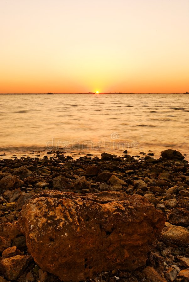 Sunset, Stones And Shoreline Royalty Free Stock Images
