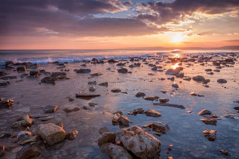 Sunset at stony coast stock image