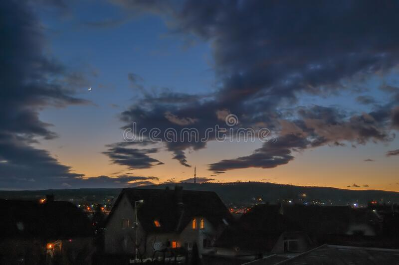 Sunset after storm with the Moon royalty free stock photo