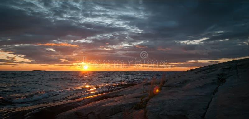 Sunset on stormy Lake Onega in Karelia stock photography
