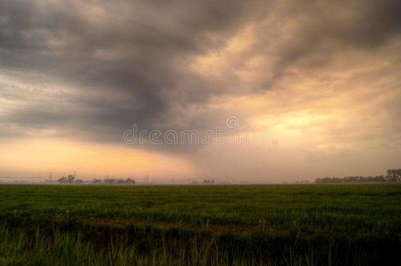 Sunset in stormy skies royalty free stock image