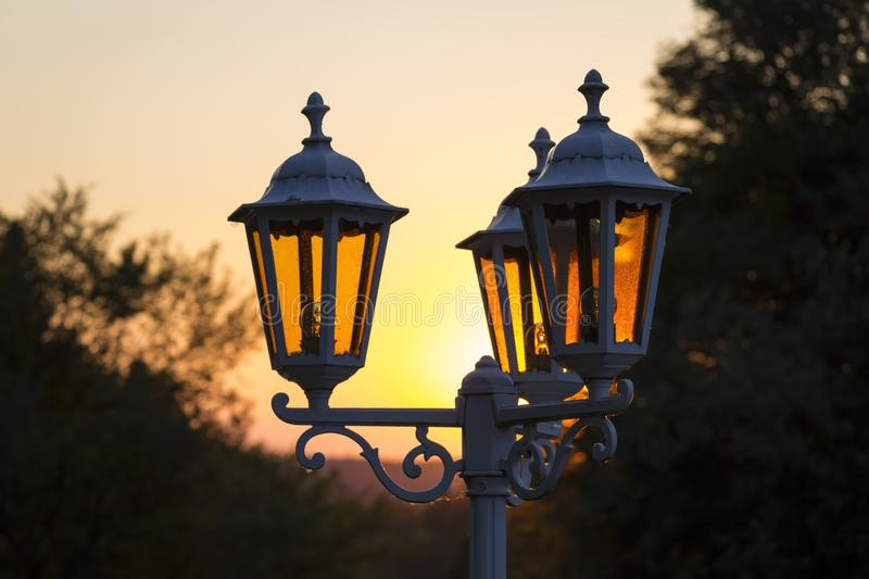 Sunset and street lamps provide a romantic atmosphere royalty free stock image
