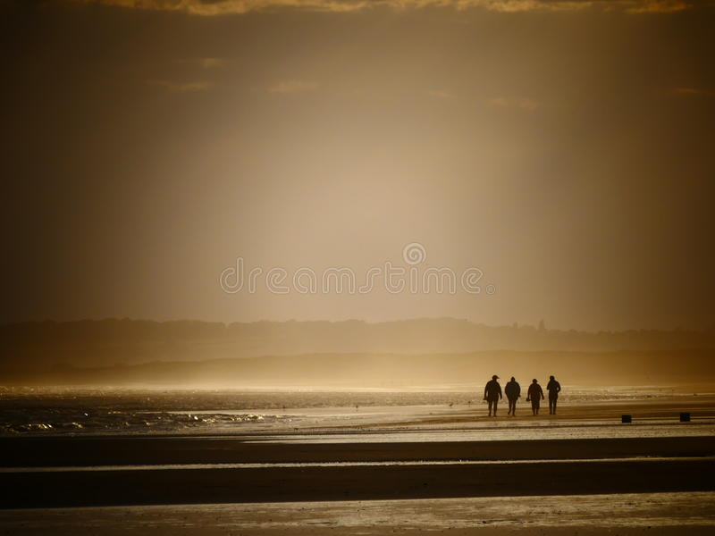 Sunset stroll along the sands stock images