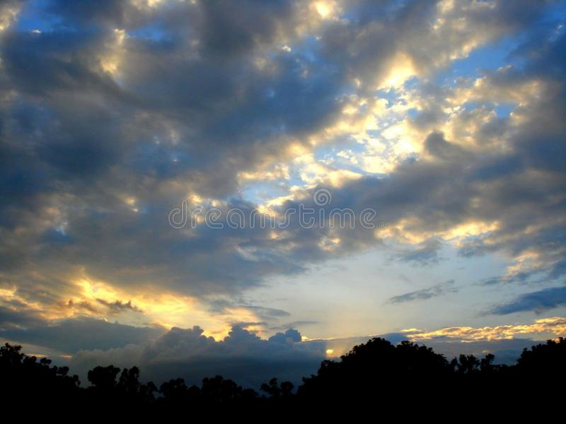 Sunset summer vacation  trees cloud blue sky evening royalty free stock photo