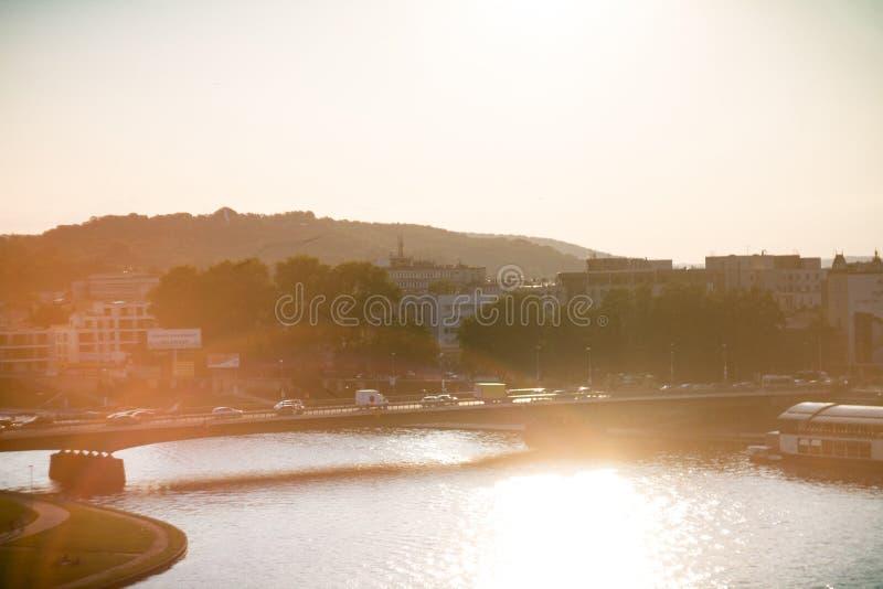 Sunset on the bridge in Krakow across the Vistula River stock images