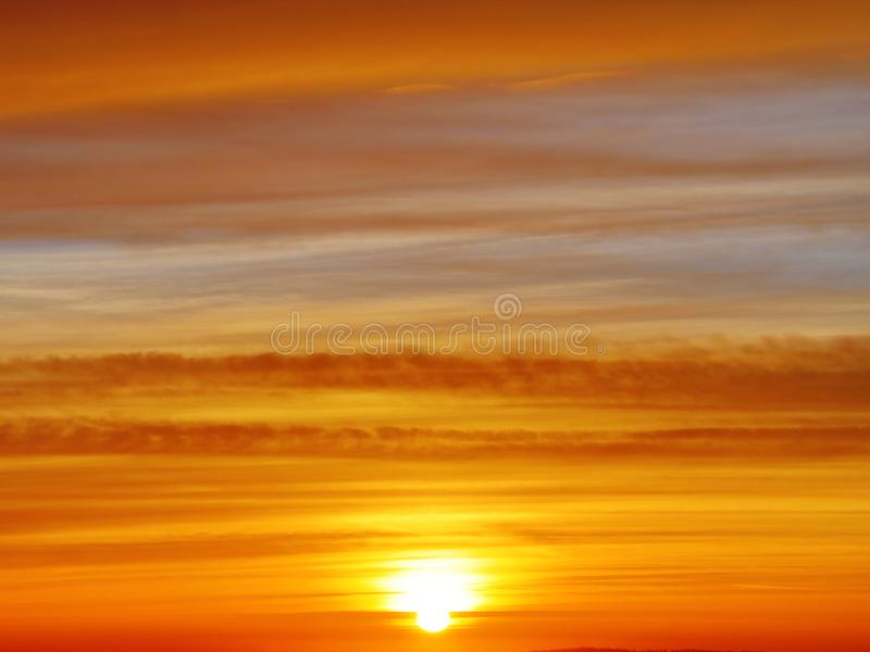The sunset or sunrise. The cloudy sky cloured in red, orange, rose, scarlet, crimson, purple, violet and blue bright and vivid col stock photography
