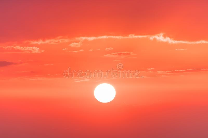 The sunset or sunrise. The cloudy sky coloured in red, orange, rose, scarlet, crimson, purple, violet bright and vivid. The sunset or sunrise. The cloudy sky royalty free stock image