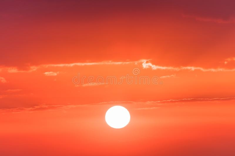 The sunset or sunrise. The cloudy sky coloured in red, orange, rose, scarlet, crimson, purple, violet bright and vivid. The sunset or sunrise. The cloudy sky royalty free stock images