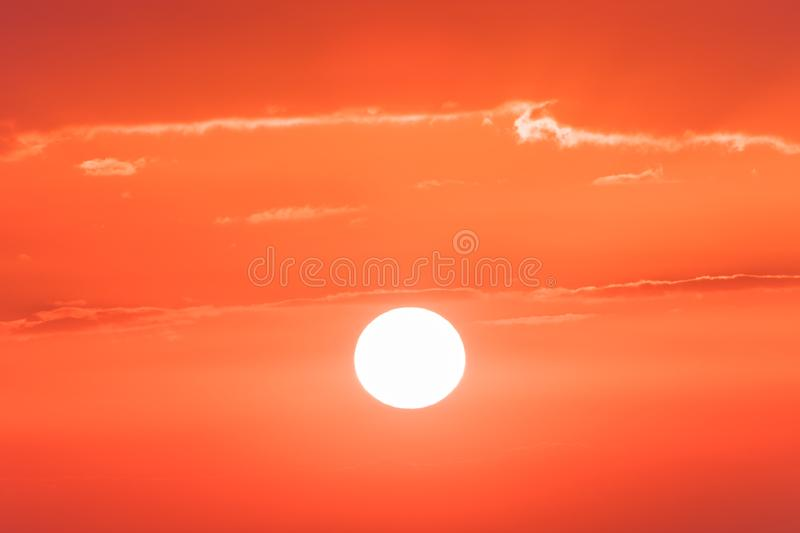 The sunset or sunrise. The cloudy sky coloured in red, orange, rose, scarlet, crimson, purple, violet bright and vivid. The sunset or sunrise. The cloudy sky royalty free stock photo