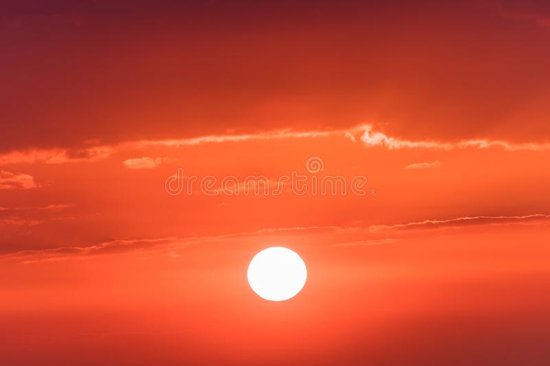 The sunset or sunrise. The cloudy sky coloured in red, orange, rose, scarlet, crimson, purple, violet bright and vivid. The sunset or sunrise. The cloudy sky royalty free stock photography