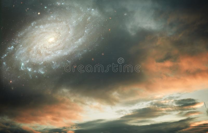 Sunset sunrise cloudy sky with galaxy and stars like fantasy, magic, religious, divine background. Sunset sunrise cloudy sky with galaxy and stars like fantasy stock image