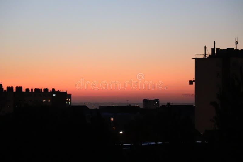 Sunset Sunrise evening morning sun light orange blue sky silhouette city. Black dark dusk stock photography