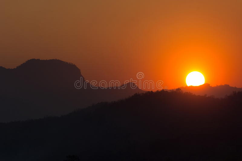 Sunset Sunrise with Mountain Silhouette royalty free stock photo