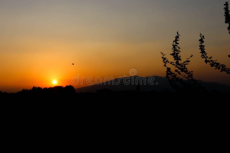 Sunset or sunrise near the mountain royalty free stock image