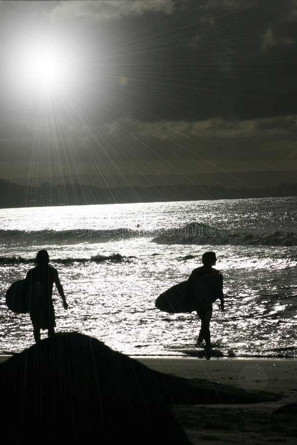 Sunset surf stock photo