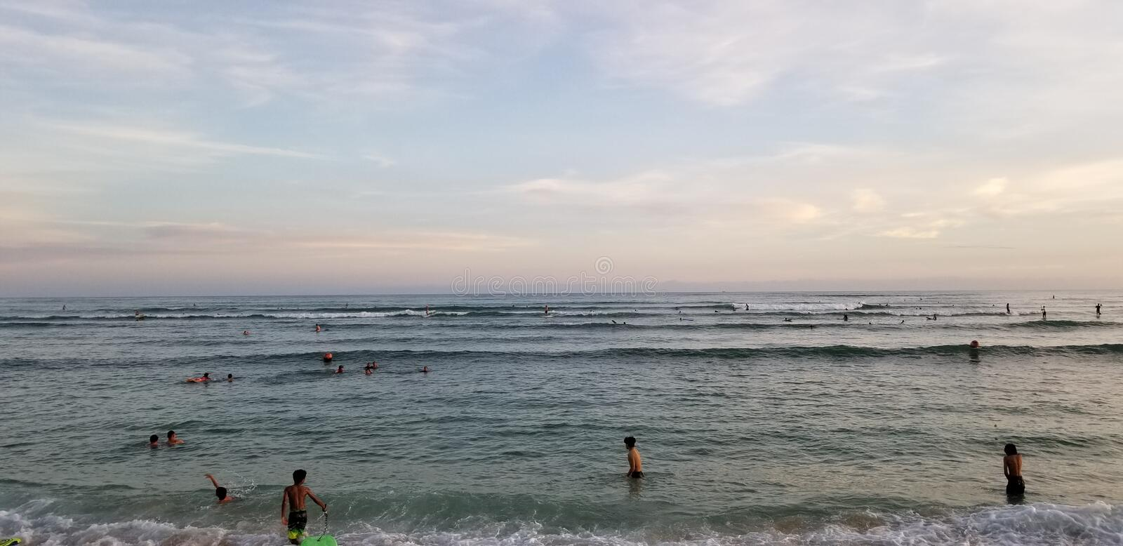 Sunset Surf Session in Ohau Hawaii. An image of a Sunset Surf Session in Ohau Hawaii royalty free stock photo